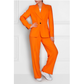 Orange 80s suit from Auvintage