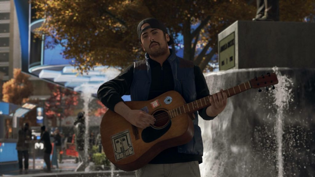 Man playing an acoustic guitar.