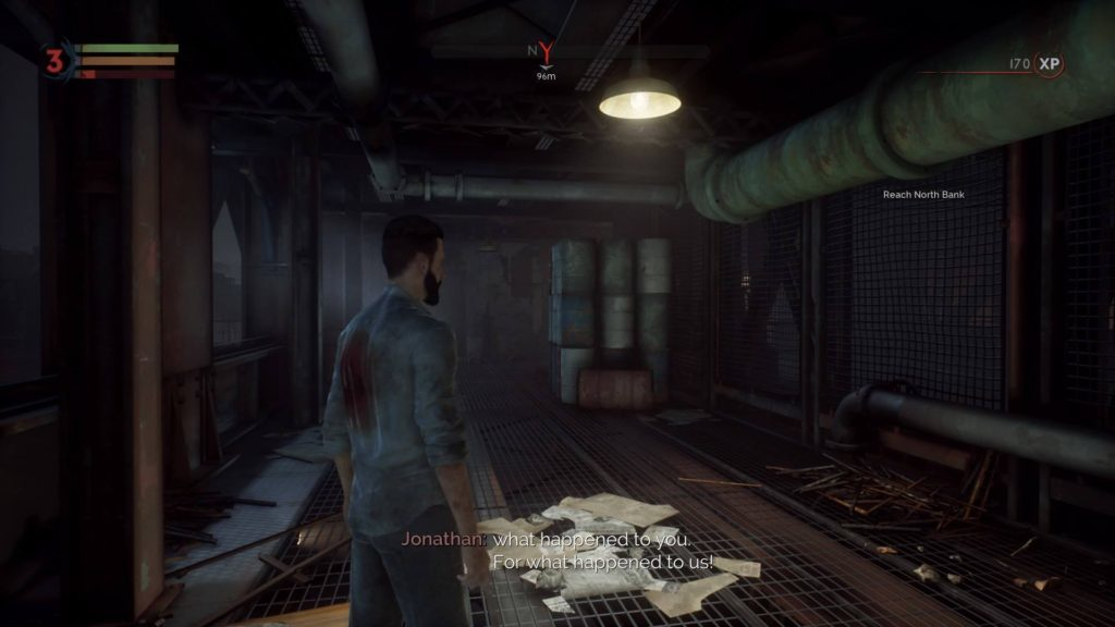 Jonathan in factory hallway, image depicts difficult to read subtitles due to poor contrast.