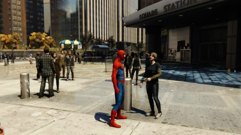 Spider-Man walking around NYC interacting with NPC.