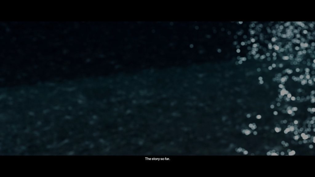 Opening cutscene, view of water, illegible subtitles shown.
