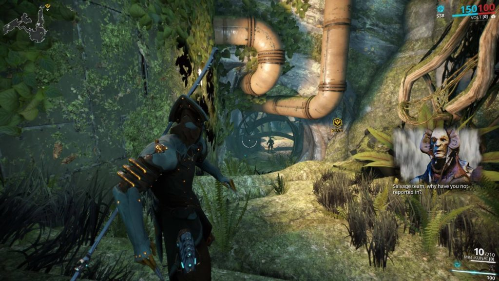 Volt Warframe looking at vine covered tunnel, picture-in-picture of Vor speaking to player.