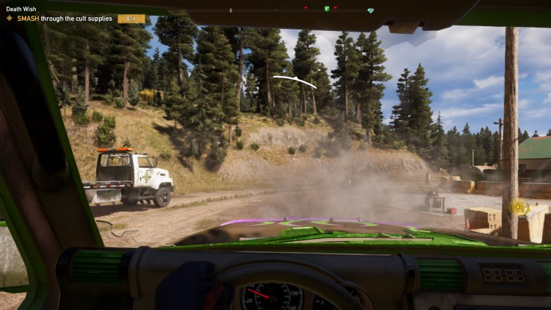 Inside of a vehicle, engine smoking, trees in the background, with enemy indicator on screen.