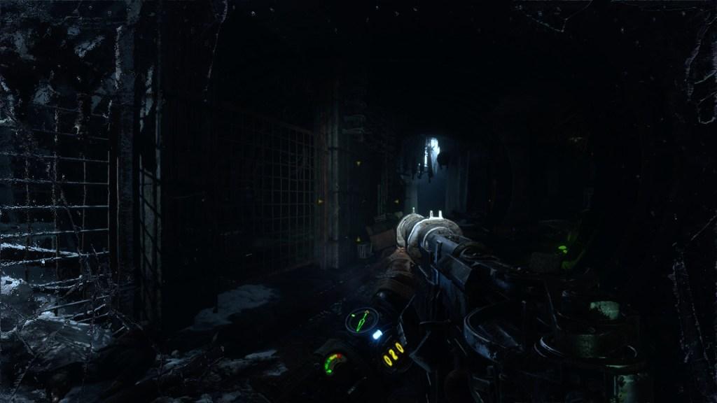 Player walking through dark tunnels carrying a gun