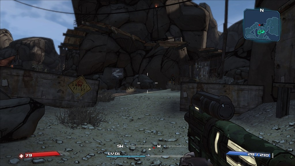Shabby wooden barricade in front of big rocks. Minimap with enemy indicator shown at top right.