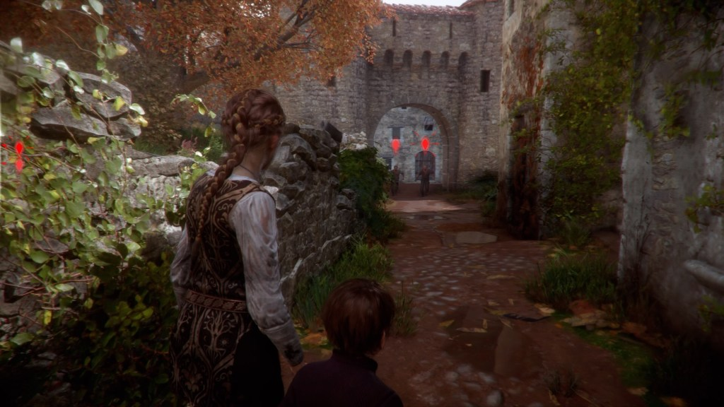 Amicia and Hugo running down a path, enemy visibility icons shown on the side of screen.