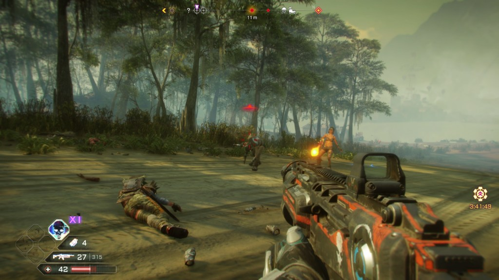 Jungle area with an enemy in the distance, gunfire damage direction indicator shown on screen.