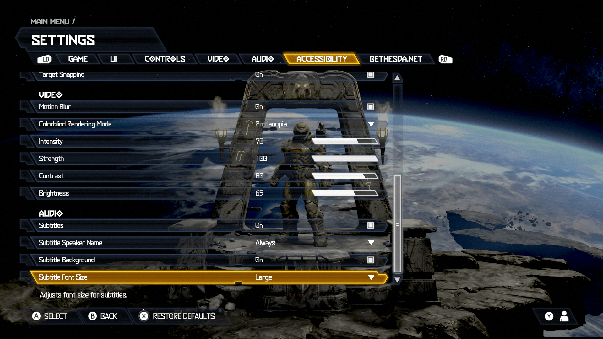 Doom Eternal Accessibility Settings Menu 2 of 2. Options include: Motion Blur set to On, Colorblind Rendering Mode showing the Protanopia setting, Intensity set at 70%, Strength set at 100%, Contrast set at 80%, Brightness set at 65%, Subtitles set to On, Subtitle Speaker Name set to Always, Subtitle Background set to On, Subtitle Font Size set to Large