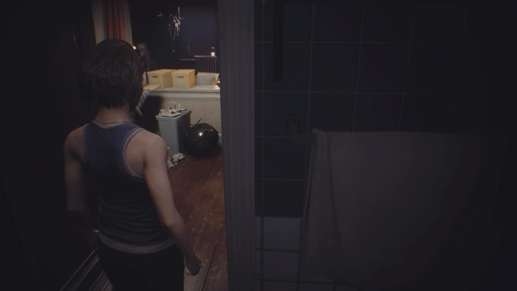 Jill leaving the bathroom in her apartment.