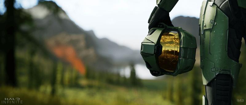 Halo Infinite key art Master Chief Helmet held by his leg