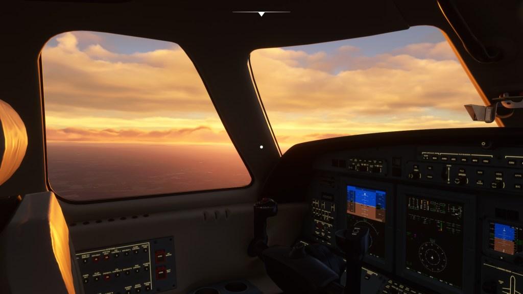 Microsoft Flight Simulator cockpit view of sunset