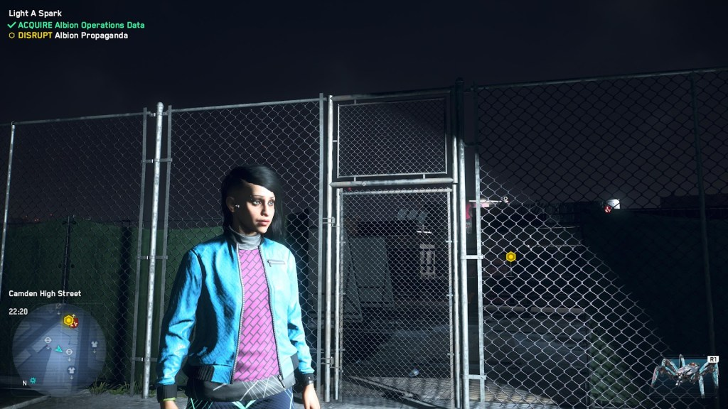 Watch Dogs character standing in front of a chain link fence.