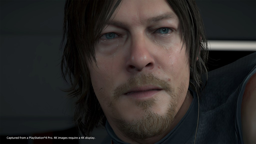 Death Stranding 's Sam crying as he looks off camera