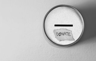 16768027 - donate box over gray background