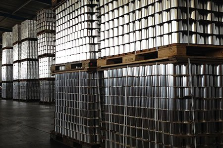 Bulk Tin Cans Stacked in Pallets in the Can It warehouse