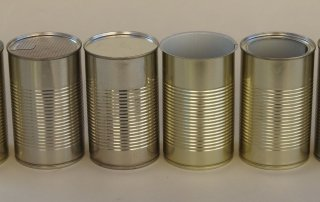 Groupshot of various metal lid options for tin cans