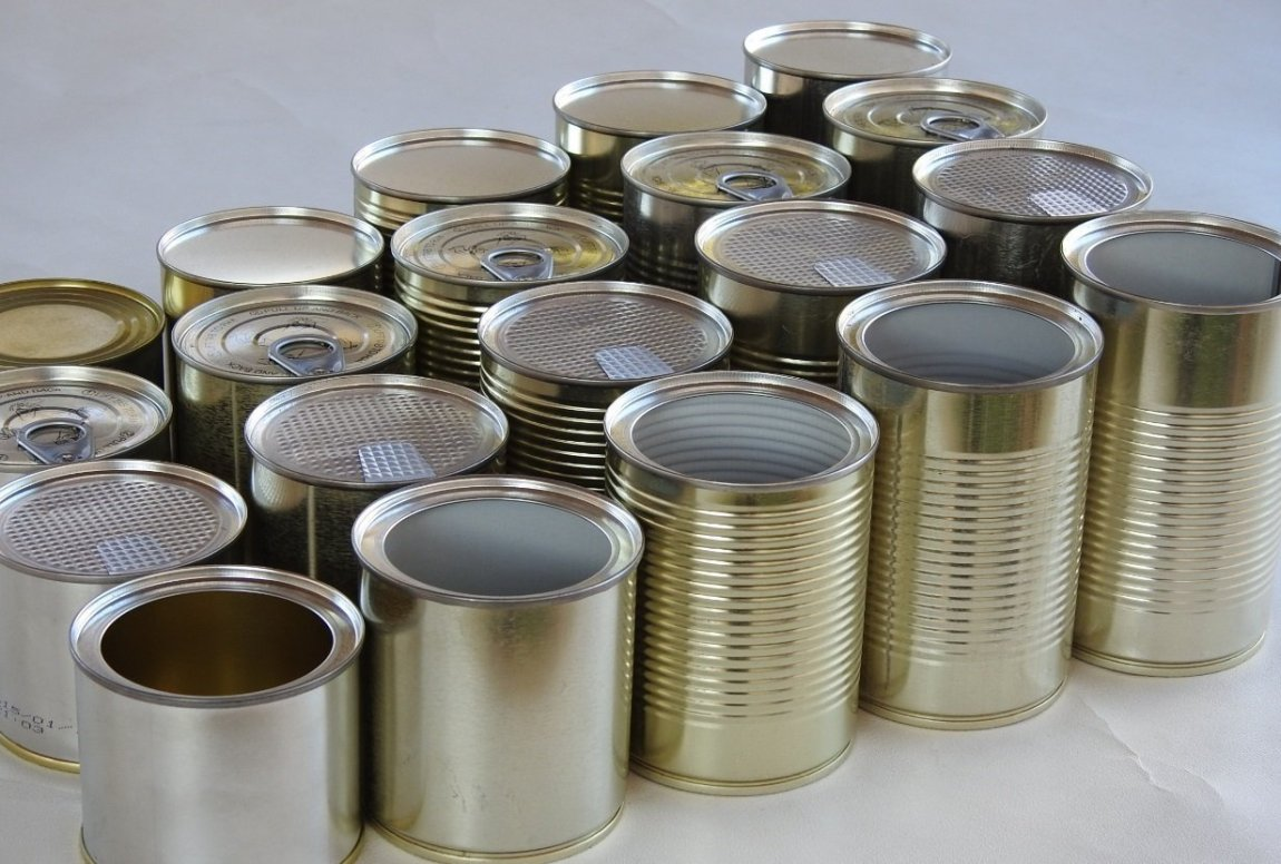 Various Tin Cans lined up with different metal tin can lids