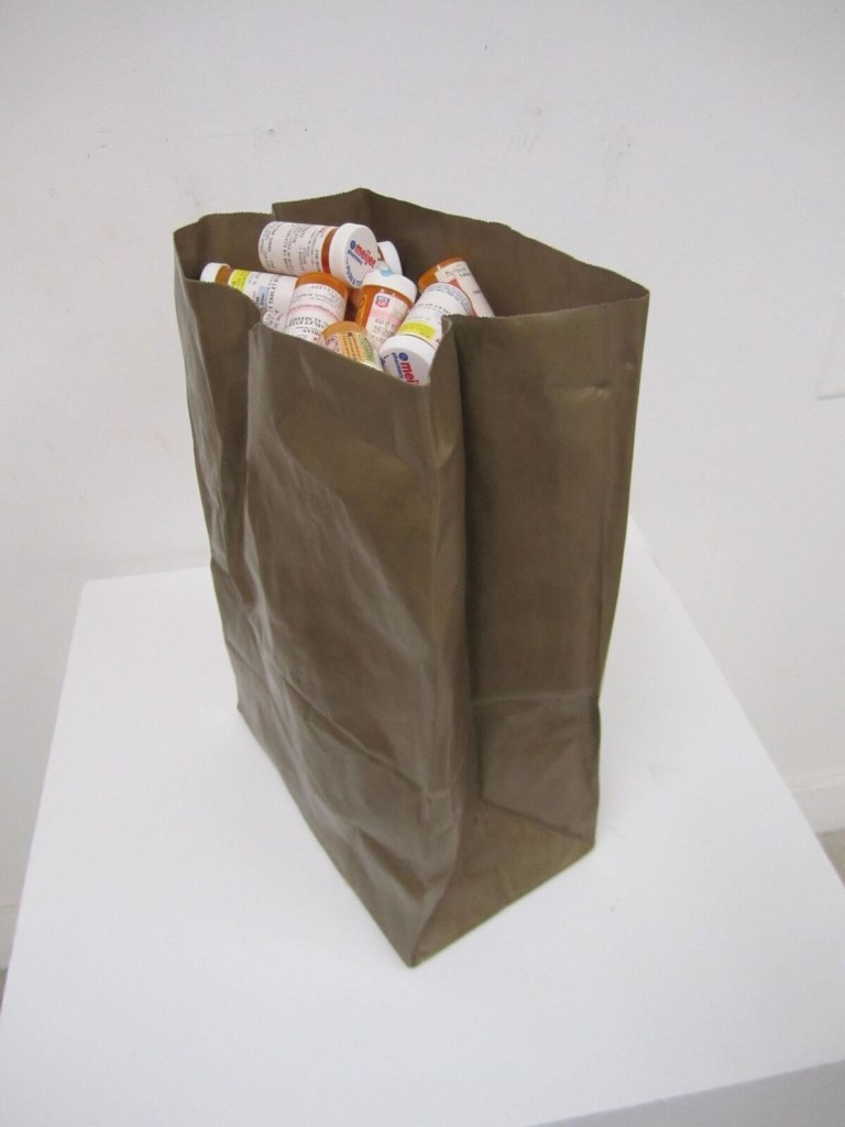 """Brian Nelson, """"This is my bag of quote (k)nots."""" Cast and fabricated bronze paper bag, prescription medication bottles."""