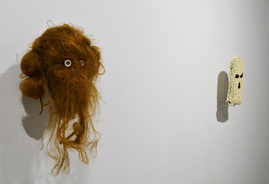 "Jonas Sebura, ""Hair Mask (for knowledge and power)"" and ""Teeth Mask (control ritual)."" Hair and resin, and cast plastic and fabric."