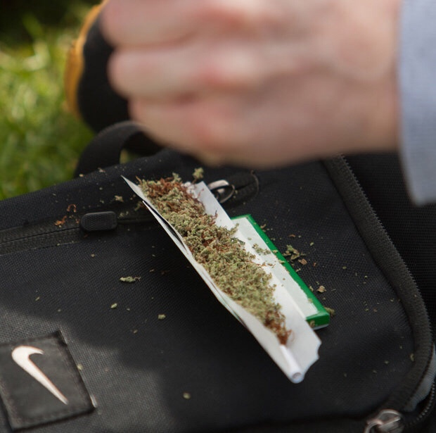 A protestor rolls a rather large spliff