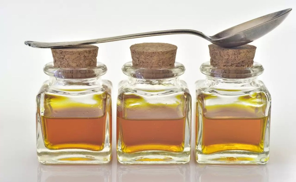 A row of tincture bottles and a spoon