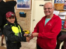 Tuesday 16th April 2019 : Tonight's photo shows club member Les Siemen presenting Connor Jacob with the winners movie voucher.