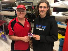 Tuesday 29th October 2019 : Tonight's photo shows club committee member David Gardiner presenting Nicholas Ringrose with the winners movie voucher.