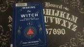 picture of a blue book on top of a Ouija board