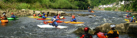 River grading: A grade two rapid at Symonds Yat on the River Wye is crowded with kayakers and canoeists.