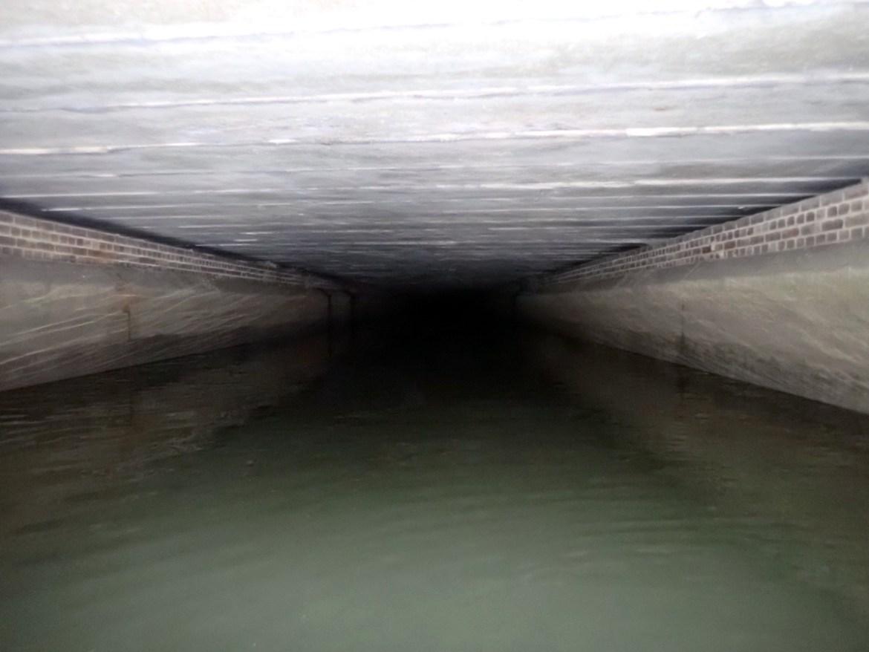 Loxford Water, a dark culvert which disappears under Barking