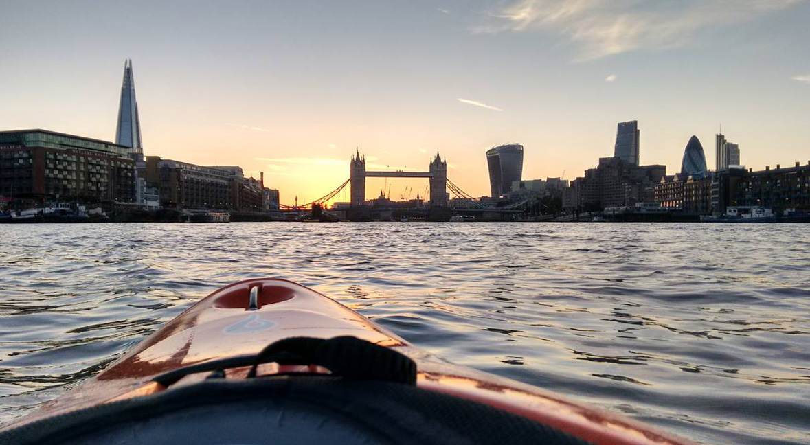 A view of Tower Bridge from a kayak on the Thames at dusk