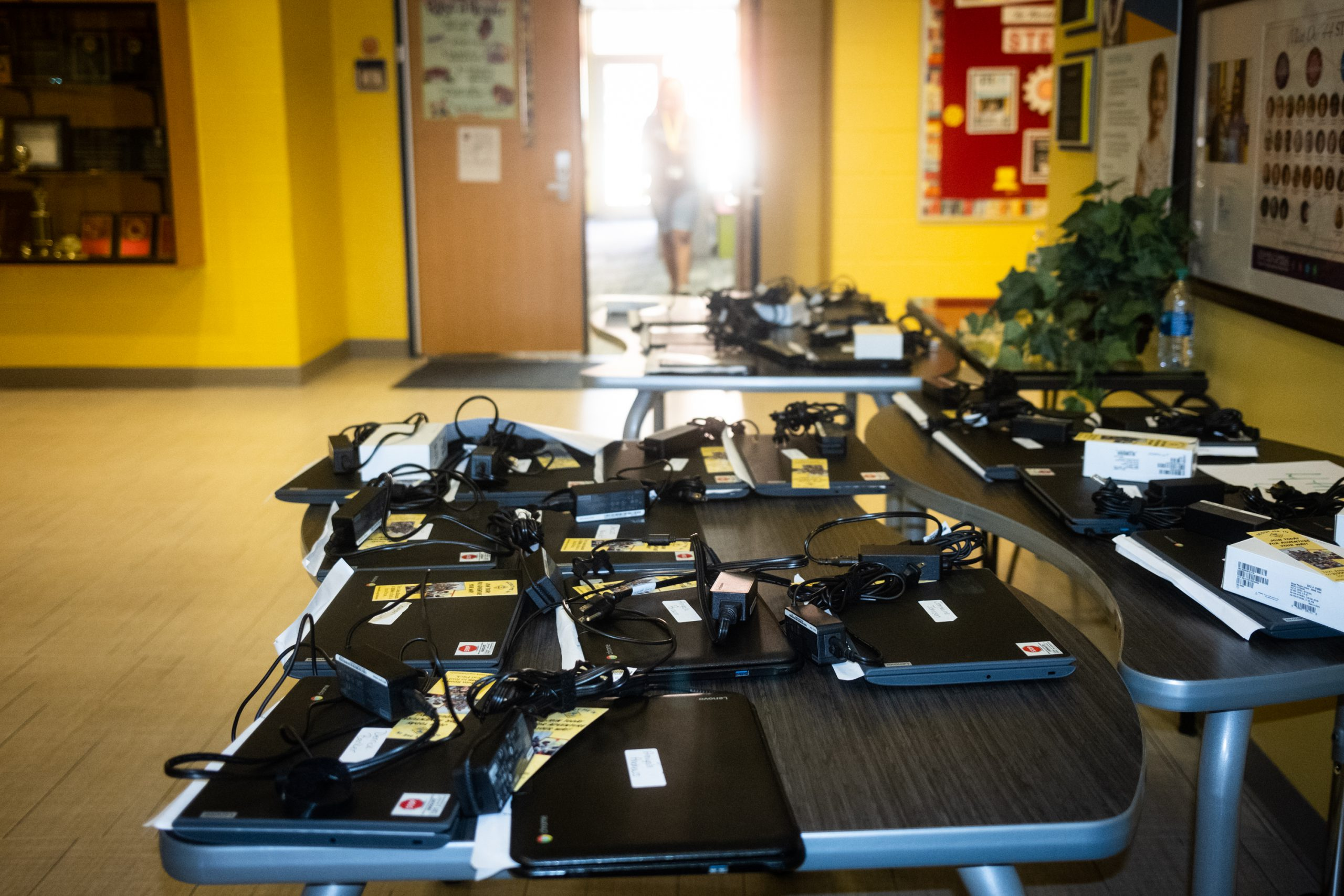 Laptops for students on table at APS building