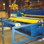 Sheet conveyor with stacker to make accurate cut stacks (click for larger view)
