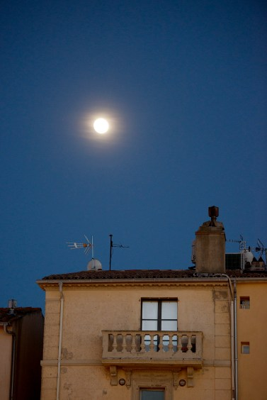 A building in the old town and the moon