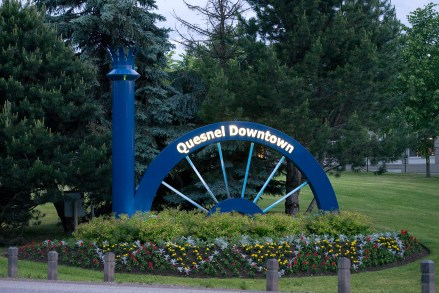 """""""Quesnel Downtown"""" sign from the Cariboo Highway #97."""