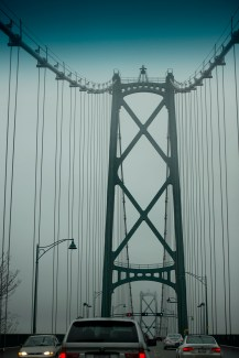 Crossing Lions' Gate Bridge in the gloom.