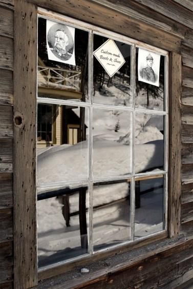 Reflections in Louis Wylde, Shoemaker, shop's window.