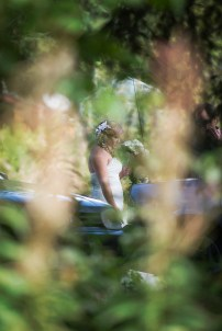 A bride arrives (through the trees)