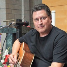 Paul Koleske Holding a Guitar.