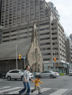 Completed in 1879, the Church of the Redeemer sits at the crossroads of Avenue Road and Bloor. The boy's shirt forms an equilateral triangle with the traffic signals. His focus is completely on jumping over the lines where black and white converge.
