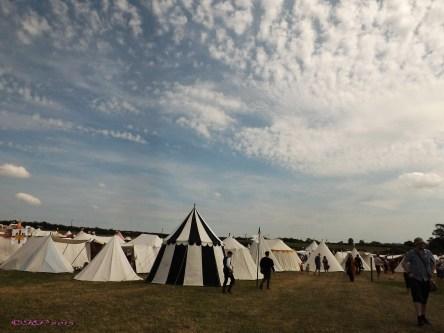 Onlooker begin to wander the tent town that has sprung up.