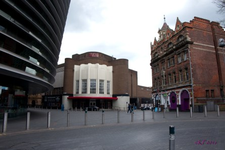 At lunch, I decided to see how the pedestrian zone trial was going over at Orton Square, named for the great playwright, Joe Orton. The ultra-modern Curve Theatre is at the left, with the 1930s Art Deco, Odeon Theatre at centre and the Queen's Building (built 1897 probably in honour of Queen Victoria) which has at times been a snooker hall and sex club, but now houses a hair salon.