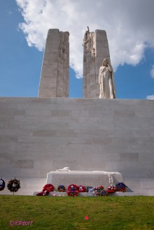 Canada Bereft, flanked by the pillars of Canada and France, weeps over the Sarcophagus.