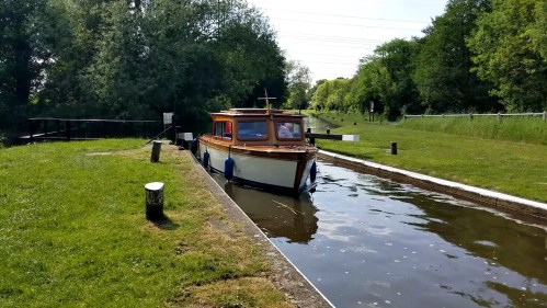 Classic runabout entering lock