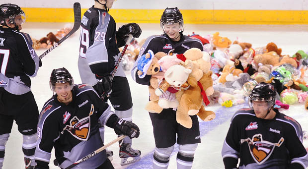 Brett Kulak with an armful of teddy bears at last year's teddy bear toss. This year he leads the Giants in scoring.