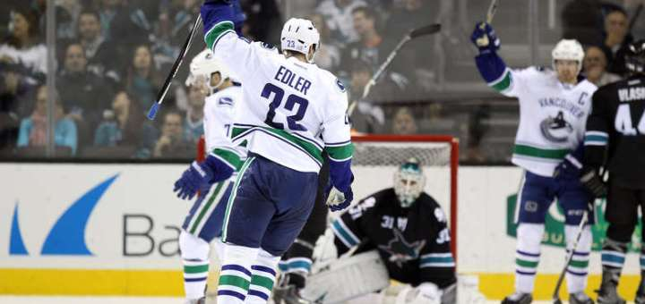 Alex Edler of the Vancouver Canucks scores against the San Jose Sharks, (Photo credit: nhl.com)