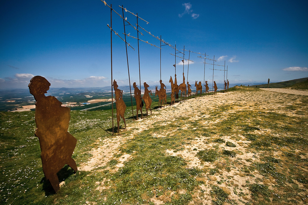 The Alto del Perdon mountain statues representing pilgrims on the Camino de Santiago near Pamplona in Spain