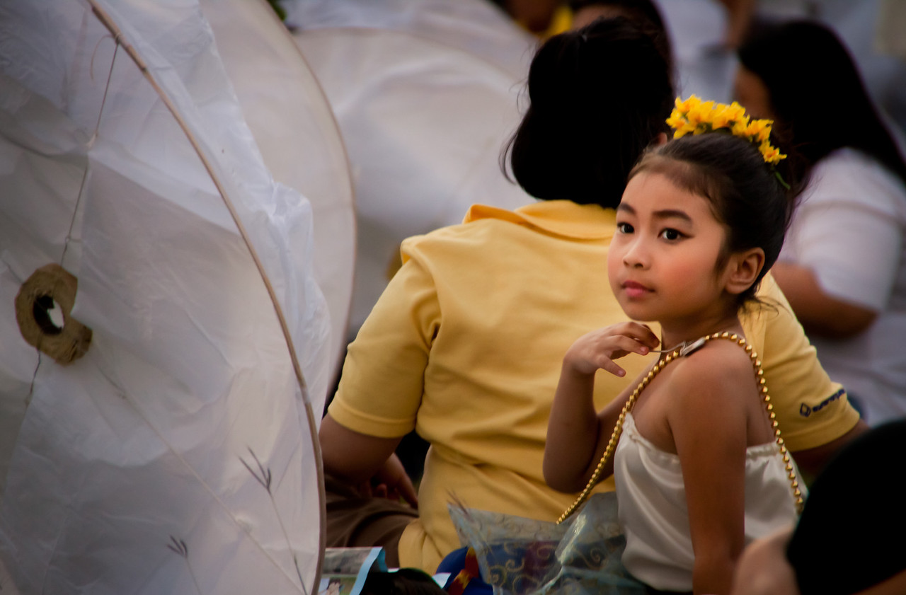 A girl waiting for the Loy Krathong Ceremony to begin in Mae Jo, near Chiang Mai, Thailand.