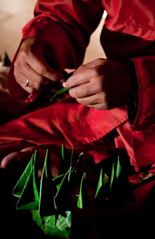 A Thai man building a krathong floating lantern with banana leaves for the Loy Krathong festival in Chiang Mai 2010