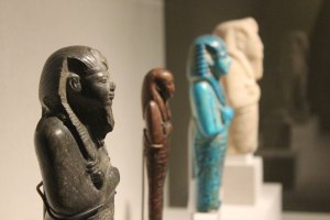 A series of shabtis, which were human figurines placed inside tombs to undertake agricultural work on behalf of the deceased in the afterlife.